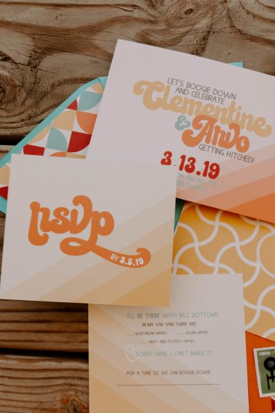 70's inspired semi-custom stationery suite with bold mustard,orange, teal and burgundy horizontal invitation and rsvp with hippie references
